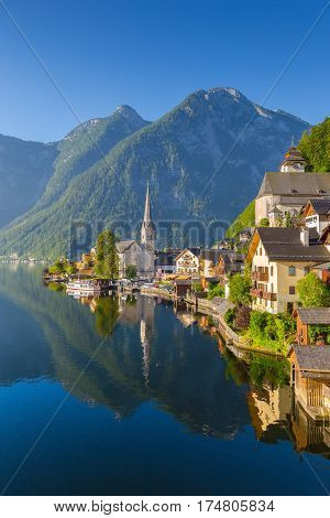 Classic postcard view of famous Hallstatt lakeside town in the Alps in scenic golden morning light at sunrise on a beautiful sunny day in summer Salzkammergut region Austria
