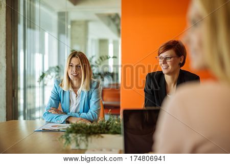 Image of a successful casual business women during meeting