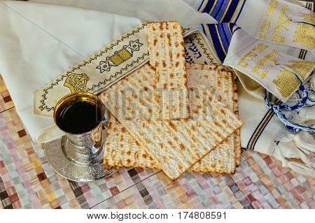 Matzo for Passover and wine on table close up