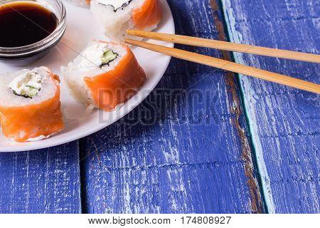 Philadelphia Maki Sushi made of Fresh Raw Salmon Cream Cheese and Cucumber with soy sauce