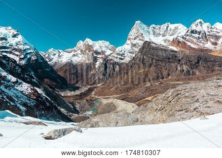 Snowy Glacier and Mountains Panorama Valley and Lakes in Himalaya pointed Peaks and bright Sky daylight View