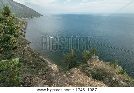 Mountain and sea. Nature composition. Wildlife Reserve Baikal. Hiking in the small mountain ranges. Lake View from a height.
