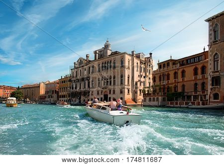 Warm summer day in romantic Venice, Italy. View from the bridge of Academia