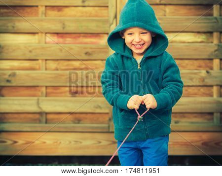 Little Boy Playing And Having Fun Outside