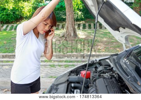 Closeup portrait Stressed woman calling for help on cell phone with mobile phone - car breakdown