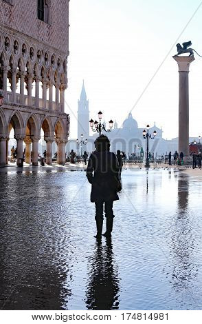 Venice Italy St Mark Square With High Tide And A Tourist Near Th
