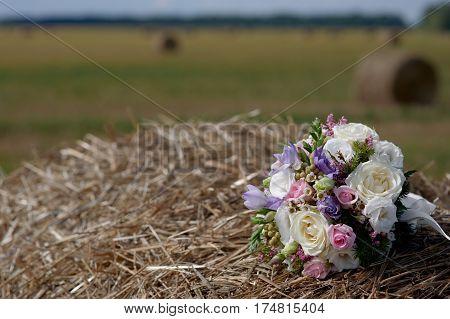 Wedding bouquet on the haystack. fashion bridal bouquet on the haystack