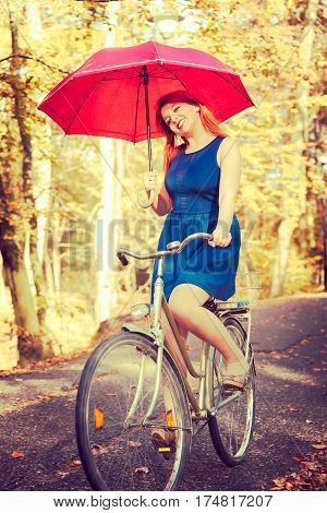 Ginger Hair Girl Is Holding Red Umbrella.
