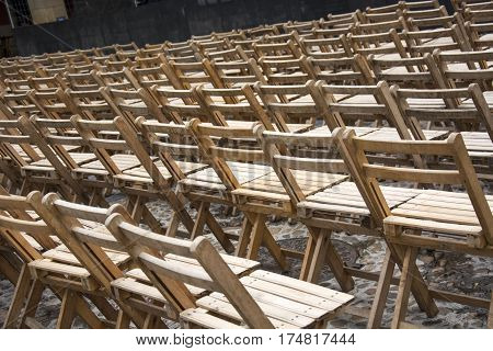 Photo of several wood chairs with sunlight