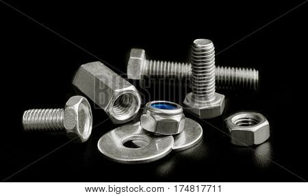 Steel screw parts isolated on black background