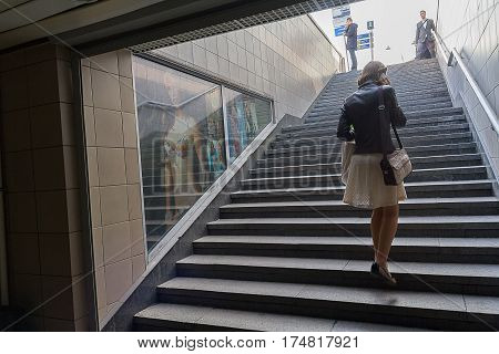 Kiev Ukraine - April 14 2016: Woman climbs the stairs of the underpass
