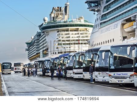 Rome Italy - June 10 2016: Bus tours and tour guides wait at the cruise port for passengers who are scheduled for tours through the city of Rome.