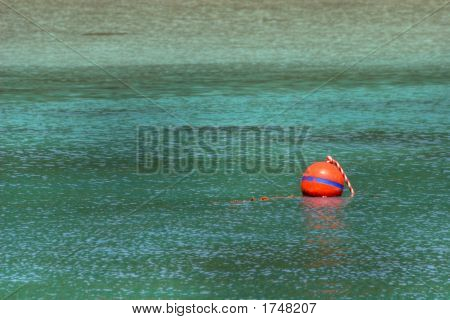 red buoy on the turquoise surface of the andaman sea ko-surin island poster