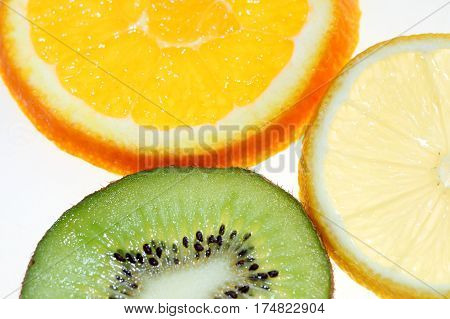 three different fruits on a white dish