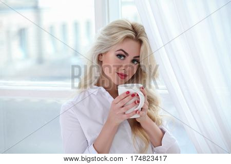 beautiful woman drinking tea in the morning