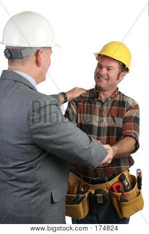 Supervisor Congratulating Tradesman
