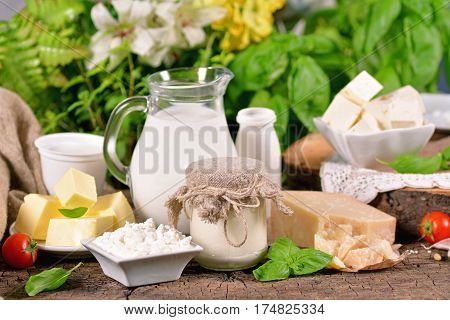 Rural dairy products on a wooden surface