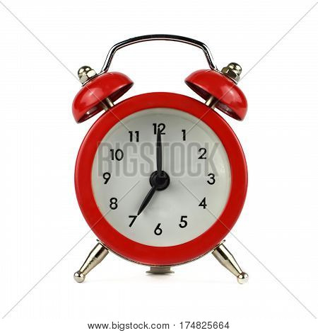 Alarm clock showing seven o'clock isolated on white background