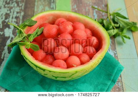 Watermelon balls with sliced lime on watermelon skin