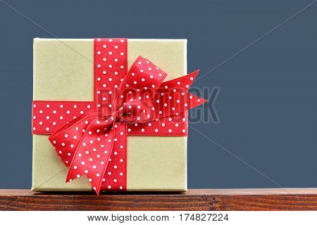 Gift box with red polka dotted bow