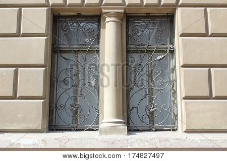 Old wooden windows with wrought iron bars