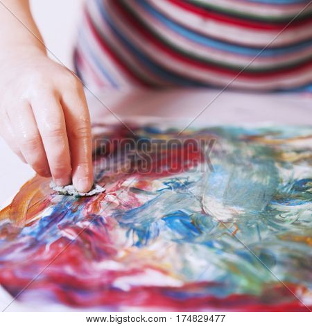 great artist (humorous picture) beautiful little baby girl draws a picture paints (postmodernism talent creativity creativity)