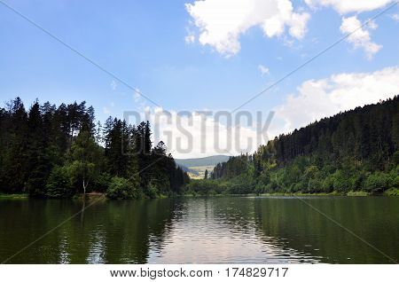 Lake surrounded by forests in summer day in east Slovakia