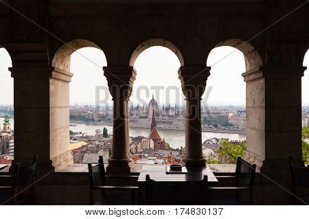 View of the Parliament in Budapest, through archways of Fisherman's Bastion, Hungary