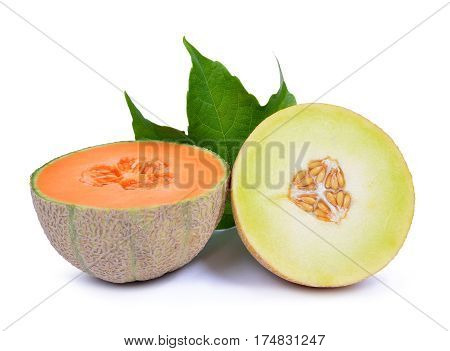 Cantaloupe melon with green leaf isolated on a white background.
