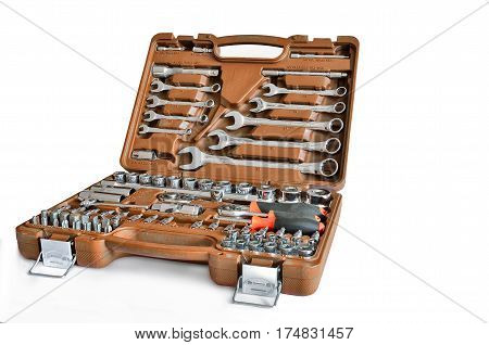 Mechanic's tools kit in the brown box close up isolated on a white background