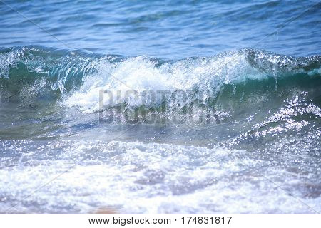 Blue Fresh Water Whitecap Waves Wash Ashore onto a Sandy Beach