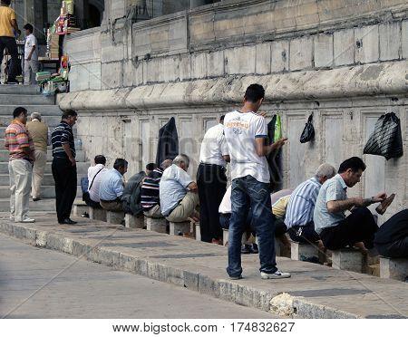 Istanbul, Turkey - Jun 28, 2008: Turkish Men Doing Ritual Ablutions (washing) Before Enter The Mosqu