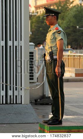 Beijing, China- Jul 3, 2011: Soldier Stands Guard At The Entrance To Tiananmen Square. Crowds Of Peo