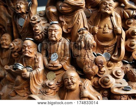 Shanghai, China - Nov 1, 2007: Wooden Carved Panel Of 18 (16) Arhats In The Jade Buddha Temple (yufo