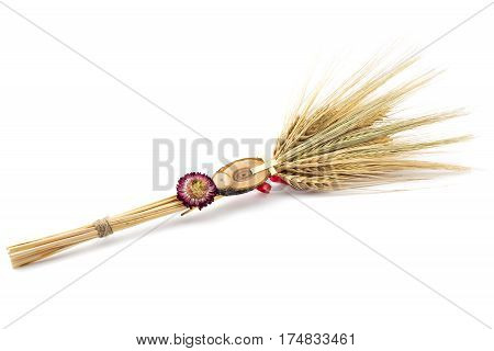 Beautiful wheat bouquet with red ribbon, slice of wood, dry flower and wooden cross, isolated on white. Bozic, Serbian ortodox christmas