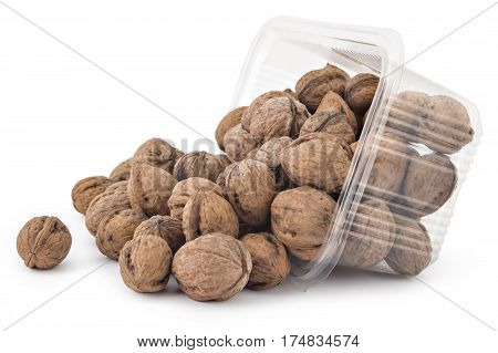 Box or punnet and spilled of dried walnuts isolated on a white background