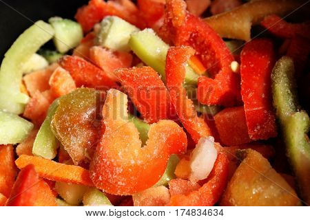 Assortment of mixed frozen vegetables bright closeup background