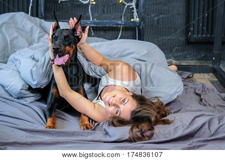Woman In Bed With Big Dog