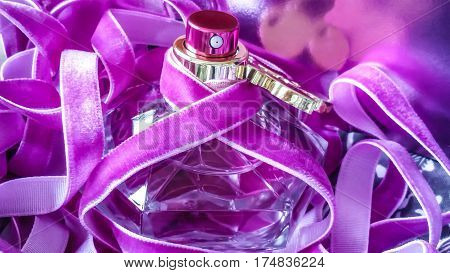 Beautiful perfume bottle on a vibrant pink background