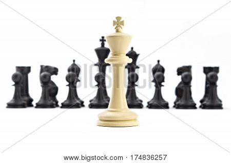 Chess business concept, leader & success. White king in front of set of black figures