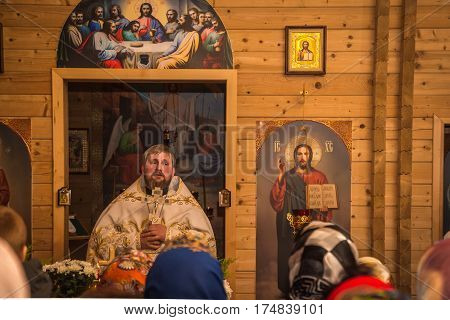 Dobrush, Belarus - May 1, 2016: The priest makes a celebratory speech to the parishioners of the church