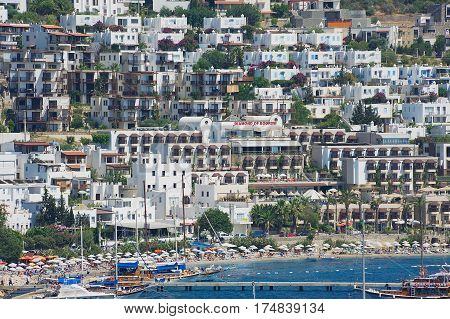 BODRUM, TURKEY - AUGUST 15, 2009: View to the beach and hotels of the resort town of Bodrum, Turkey.