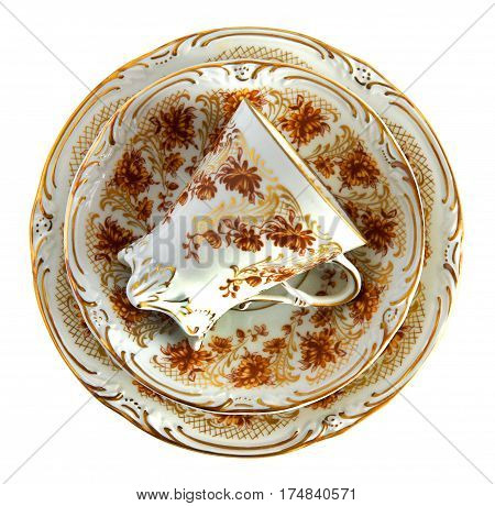Antique porcelain tea cup and saucers on white background