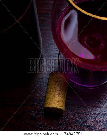 drop wine stopper bottle movement red background splash glass