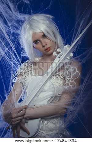 Folk, Passion for classical music, woman dressed in white lace dress playing a violin