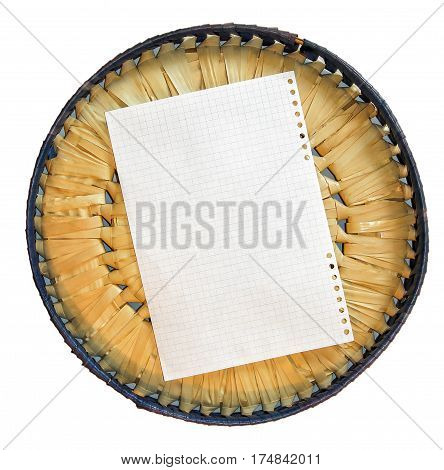Piece Of Paper Element  Laid Out On Basket Wicker Lid