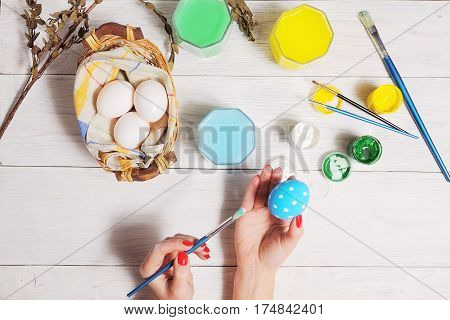 Close Up Of Colorful Easter Eggs In A Basket. Brush And Paint