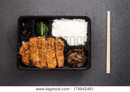 Japanese Food Tonkatsu Rice And Vegetable Take Away On Table Background