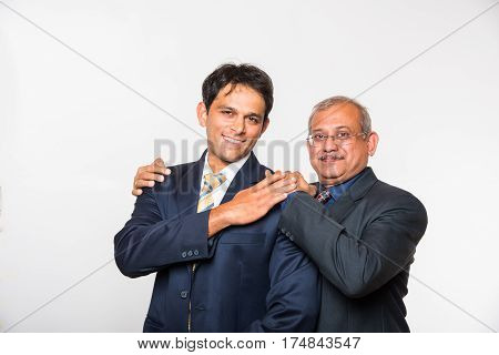 Family business,team work, success. Portrait of Indian Young and senior businessman, lawyer, architect. two generations concept, father and son