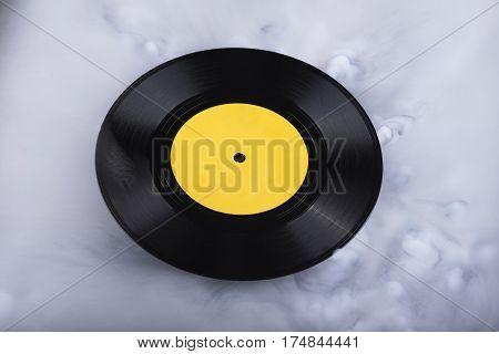 Vinyl record in clouds. Conceptual image. Retro sound